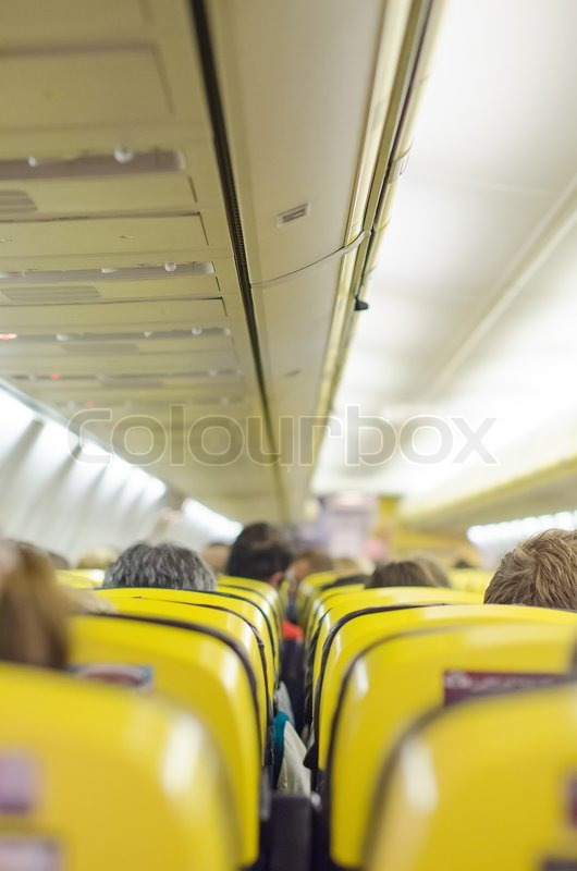 Interior inside of the plane with passengers, stock photo
