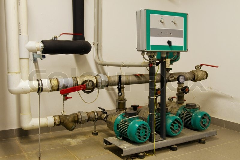 Water pipes in the boiler room and electric motors, stock photo