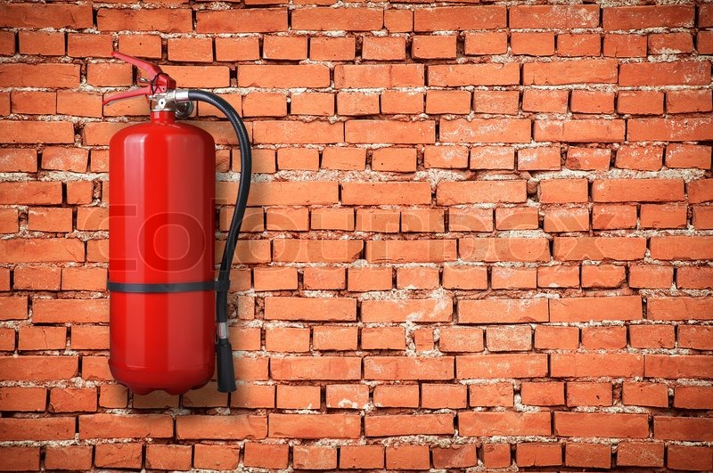 Fire extinguisher on brick wall , stock photo