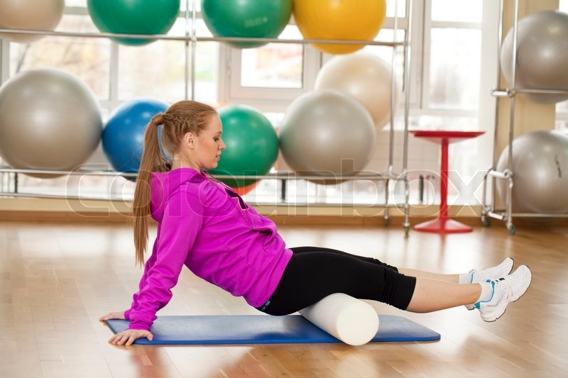 Fitness young woman in a sports hall, stock photo