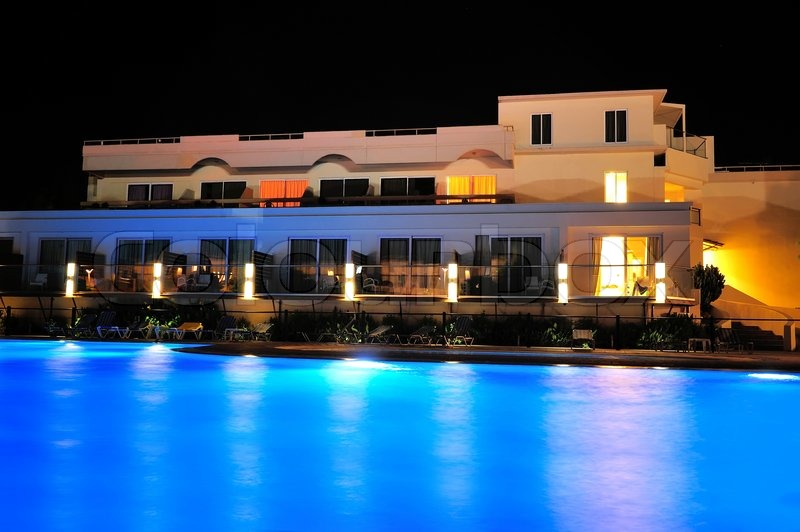 Night pool side of rich hotel, stock photo