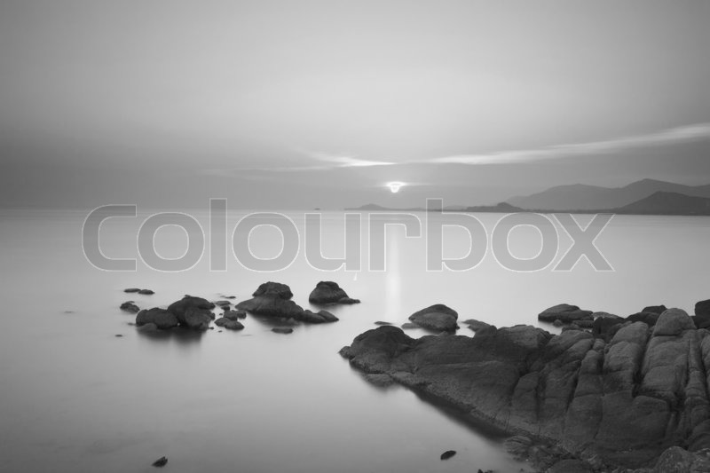 Long exposure dramatic tropical sea and sky sunset in black and white tone, stock photo
