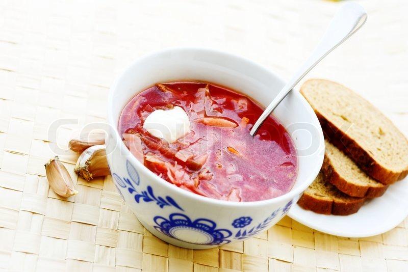 Stock image of 'ukrainian and russian beet soup (borscht) with garlic ...