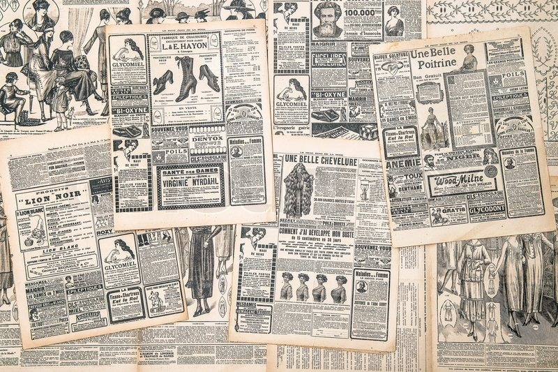 Newspaper pages with antique advertisement, stock photo