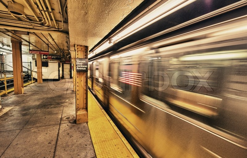 Subway train speeding up in New York City underground system, stock photo