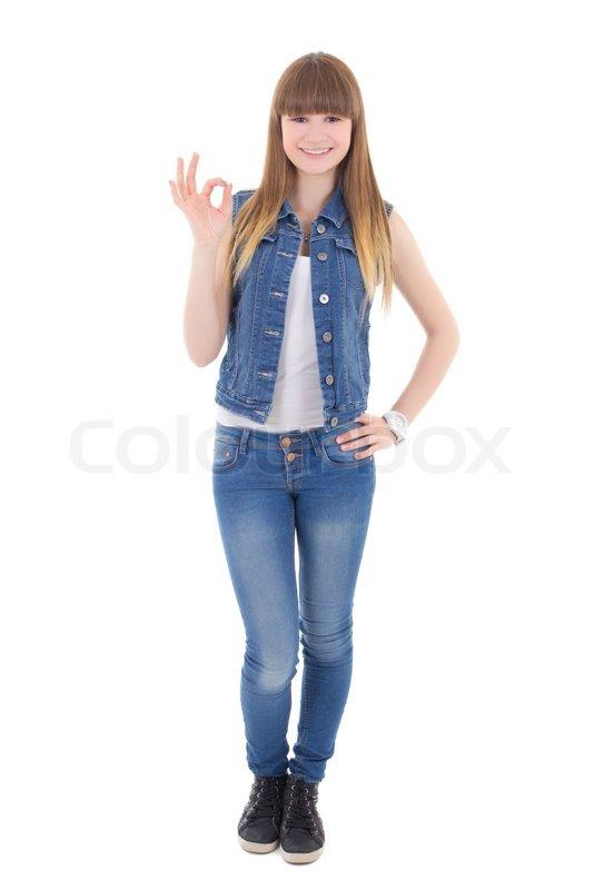teenager m dchen in jeans kleidung zeigt ok zeichen. Black Bedroom Furniture Sets. Home Design Ideas
