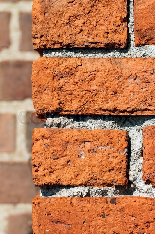 The Corner Of An Old Building Photographed Close Shows Rustic Colorful Clay Bricks