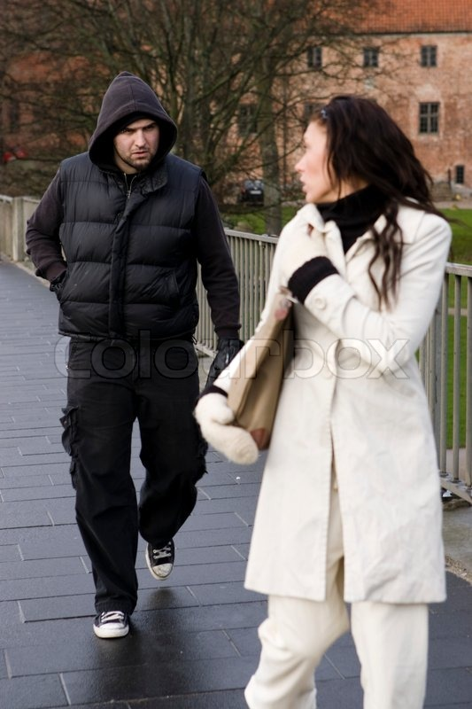 A male mugger attacking a woman walking ... | Stock image | Colourbox