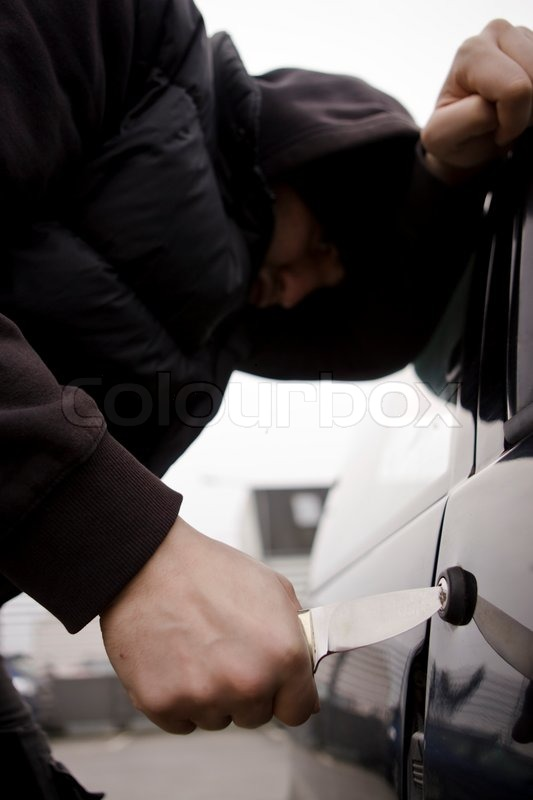 Stock image of 'A man trying to steal a car'