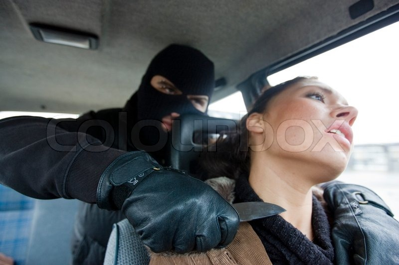 Woman Attacking  Men In Car With A Knife