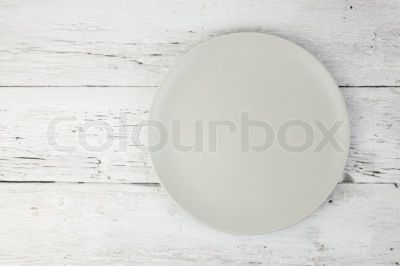 Empty clean plate on white table, stock photo
