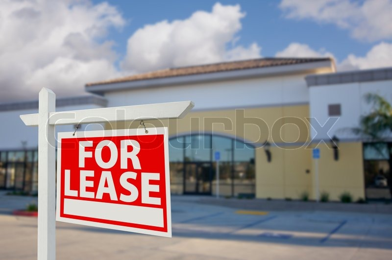 Vacant Retail Building with For Lease Real Estate Sign in Front, stock photo