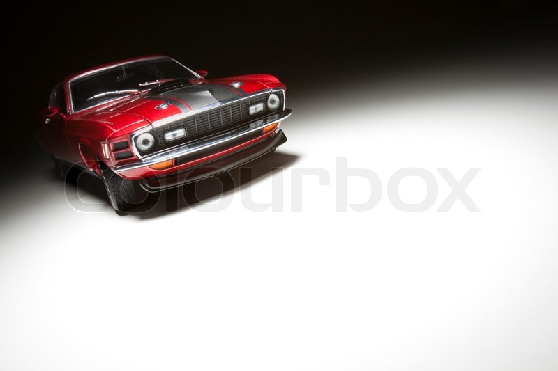 Muscle Sports Car on White Under Spot Light, stock photo