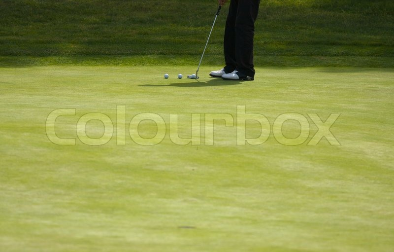 Golfer Putting on the Green one Summer Day, stock photo