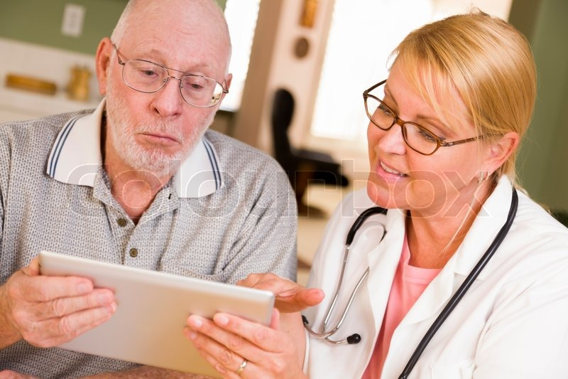 Doctor or Nurse Talking to Senior Man with Touch Pad Computer, stock photo