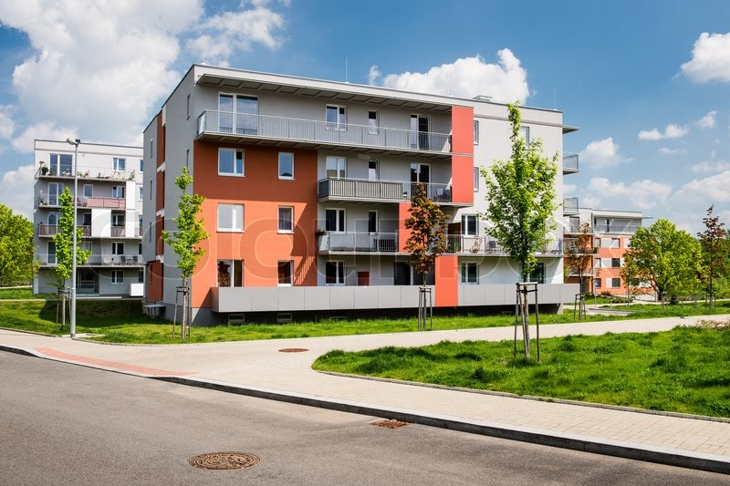 Public view of newly built block of flats in thre green park, stock photo