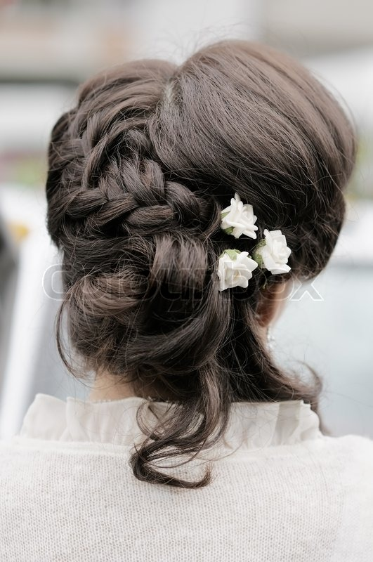 ... hairstyle with flowers, focus on flowers | Stock Photo | Colourbox