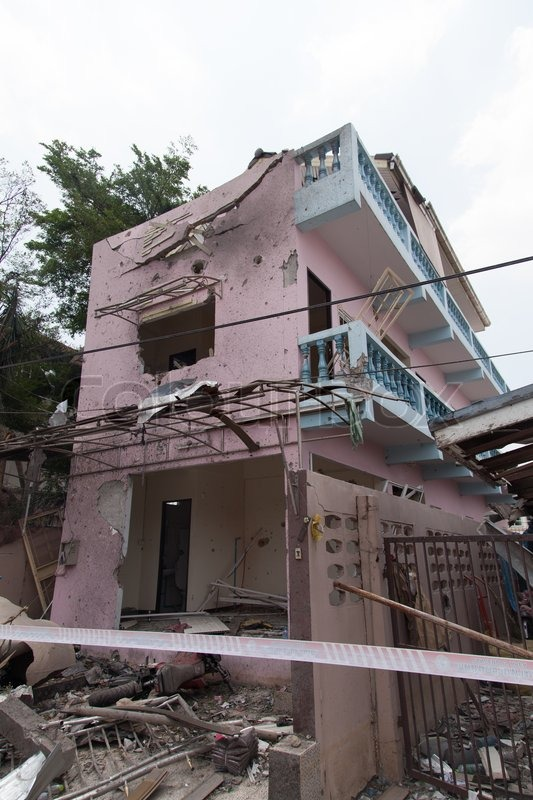 Home damaged by bombs, stock photo