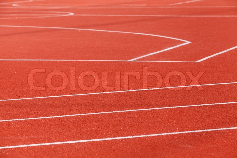 Red sports ground with white marking lines, stock photo