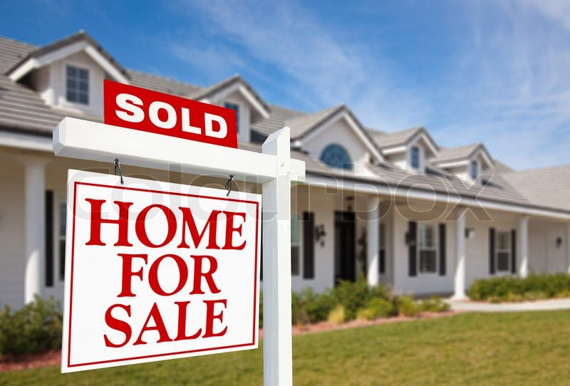 Sold Home For Sale Sign in front of Beautiful New Home, stock photo