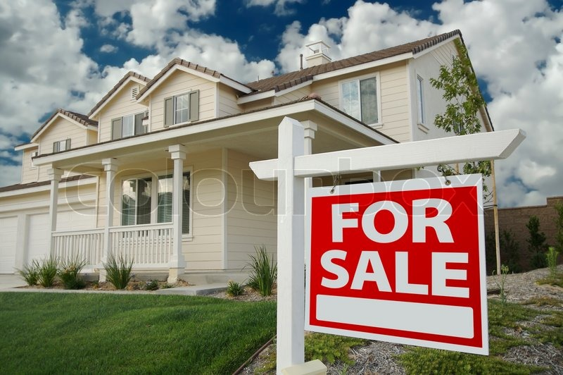 Home For Sale Sign in Front of Beautiful New Home, stock photo