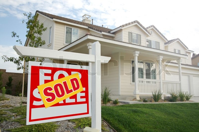 Sold Home for Sale Real Estate Sign in Front of New House, stock photo
