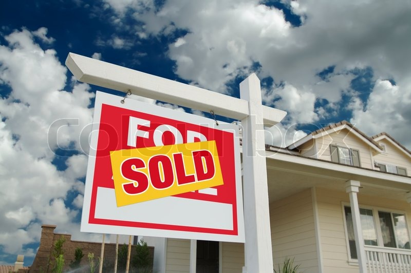Sold Home For Sale Sign in Front of New House, stock photo