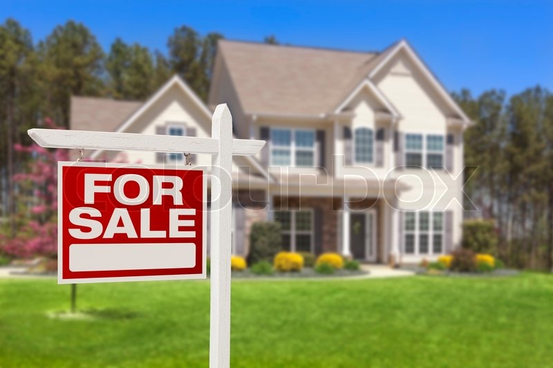 Home For Sale Real Estate Sign and Beautiful New House, stock photo