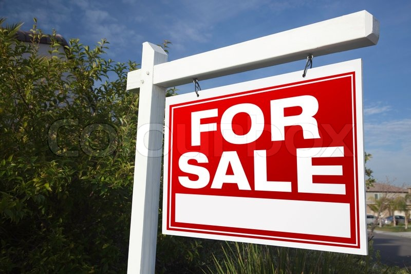 For Sale Real Estate Sign In A Neighborhood, stock photo