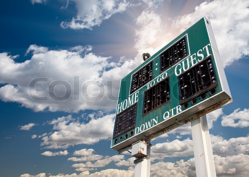 HIgh School Score Board on a Dramatic Blue Sky with Clouds and Sun Rays, stock photo