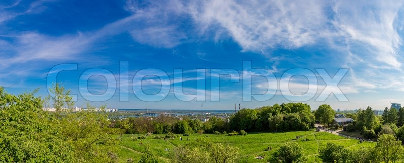 Panorama of city landscape and nature. Kiev, Ukraine. Green trees, architecture, and blue river, stock photo
