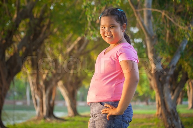 Portrait Asian Fat Girl In The Park On   Stock Photo -2077