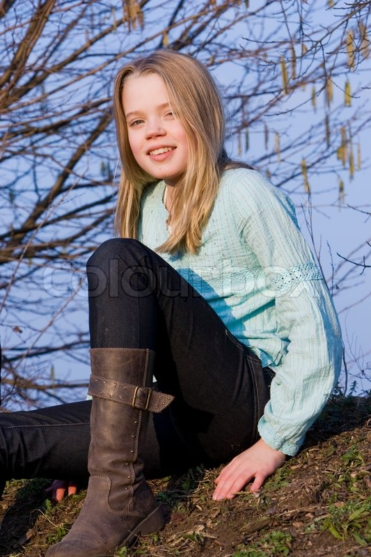 a smiling teenage girl with boots on stock photo colourbox