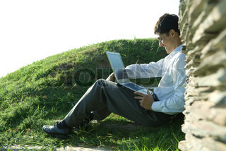 Image of 'outside, computer, sitting'