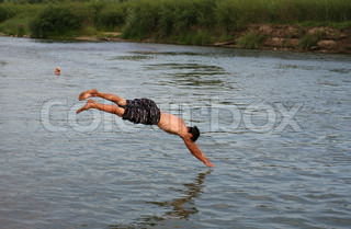 People swim in the river