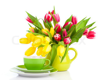 yellow tulips flowers with cup tea, on a white background. breakfast for mommy, happy mothers day, morning drink, romantic still life, fresh flowers