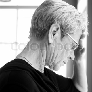 Side view of an elderly woman with a headache