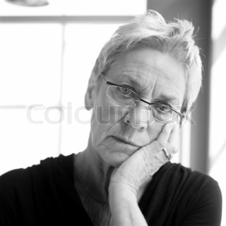Black and white image of a sad elderly caucasian