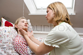 A mother checking the neck of her sick daughter
