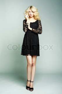 Fashion photo of young magnificent woman. Girl posing