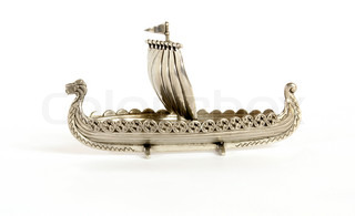 Souvenir in the form of boat - the medieval ship with shallow draft, movable oars and sail, isolated on a white background