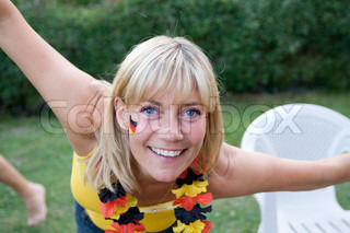 Smiling face of a female german football fan