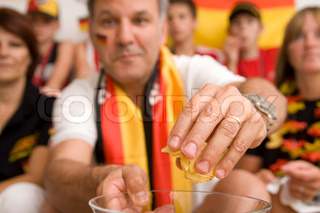 Blurred image of a german fans watching football