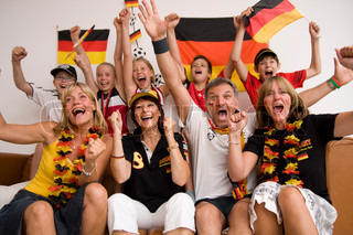 Excited german football fans watching a match