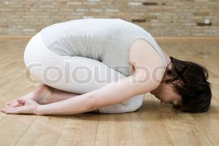 Image of 'yoga, fourty, indoors'