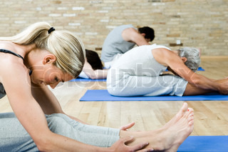 A group of people exercises on the floor