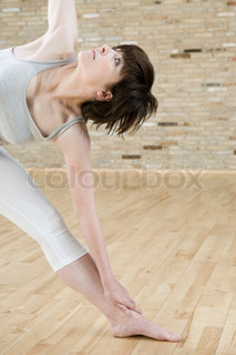 Stretching exercises on the floor in a fitness centre