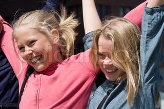 Smiling faces of teenage girls