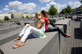 Teenage girls in Berlin's Holocaust Memorial  using their cellphone