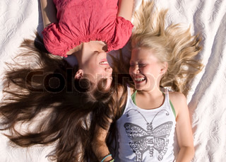 Top view of grinning teenage girls